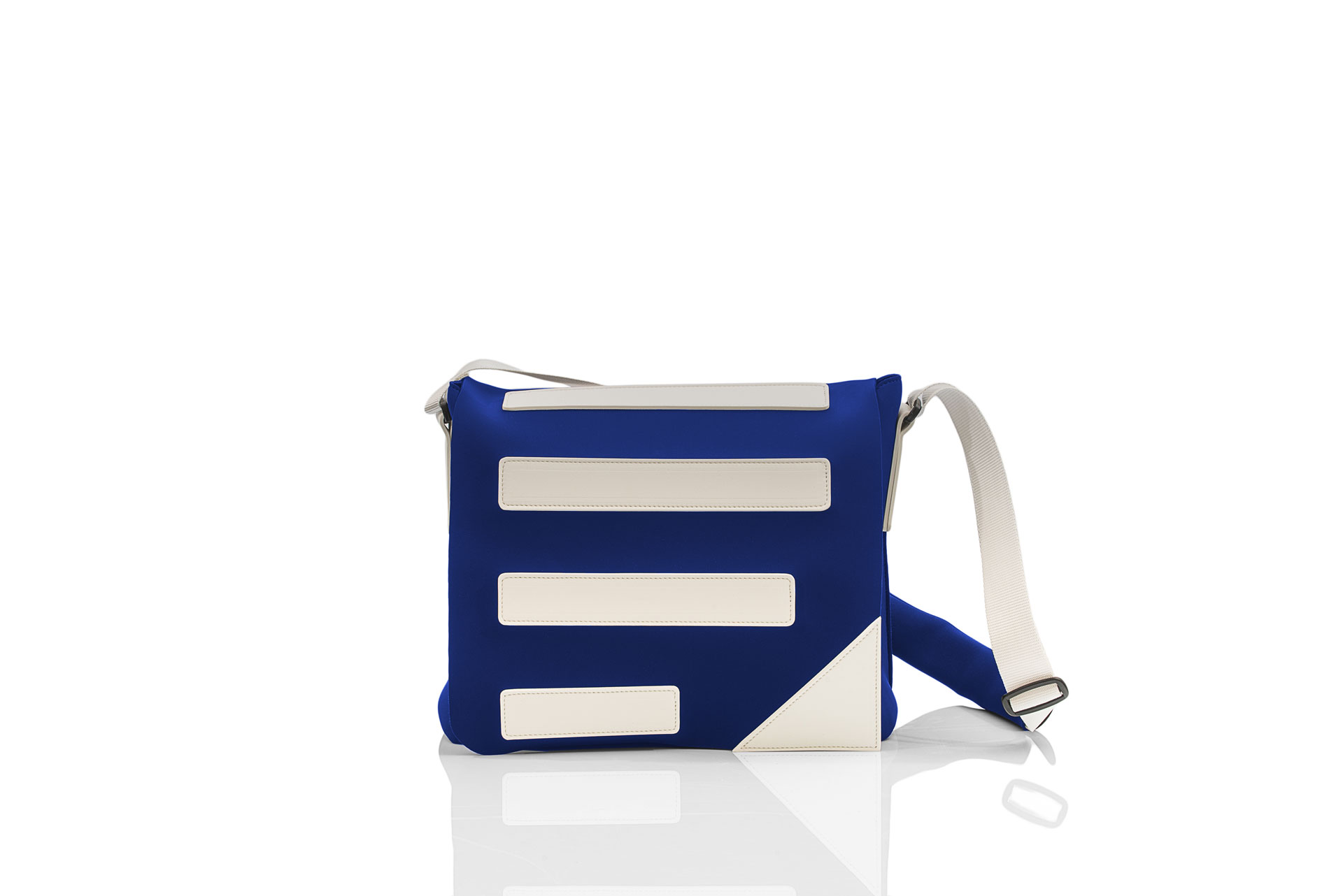 """Postina unisex is an incredible """"every day use"""" handmade bag with a neoprene effect material."""
